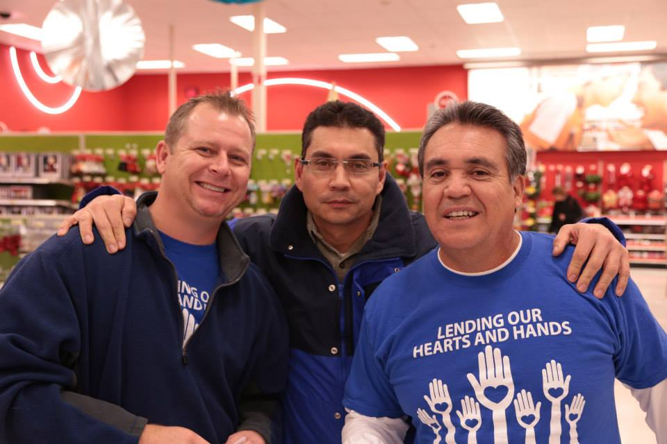 Saul Gonzalez with Truckload employees at the Truckloads of Treasures event at Target in Joplin, MO, December 10, 2013.