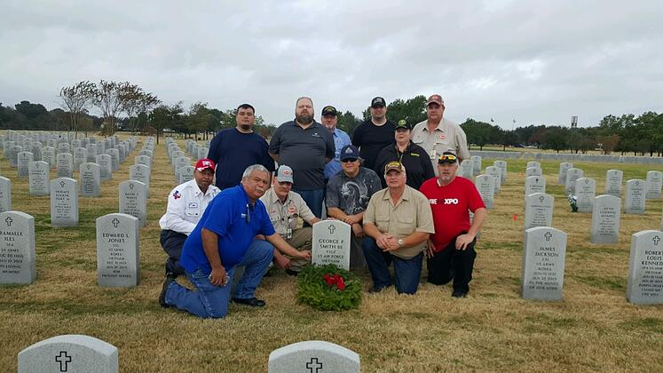 Drivers gather to lay a wreath in Houston as part of Wreaths Across America Day